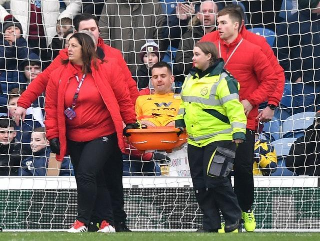 Tom Heaton is stretchered off against Burnley