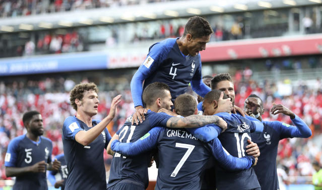 France's Kylian Mbappe, (10), is mobbed by teammates after scoring the opening goal of the game during the group C match between France and Peru at the 2018 soccer World Cup in the Yekaterinburg Arena in Yekaterinburg, Russia, Thursday, June 21, 2018. (AP Photo/David Vincent)