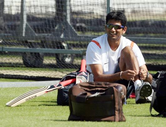 India's bowling coach Venkatesh Prasad  puts his shoes on during a net practice at Lord's cricket ground, London. (AP Photo)