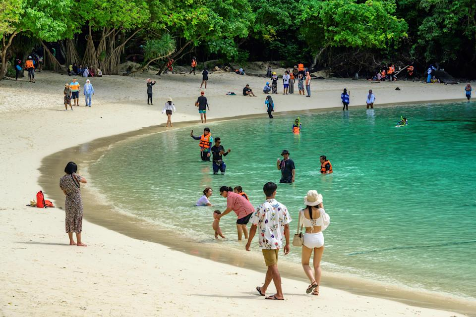 This photograph taken on November 25, 2020 shows local tourists enjoying the beach of one of Thailand's Koh Hong islands