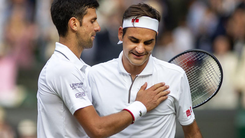 Novak Djokovic and Roger Federer after their epic Wimbledon final. (Photo by Tim Clayton/Corbis via Getty Images)