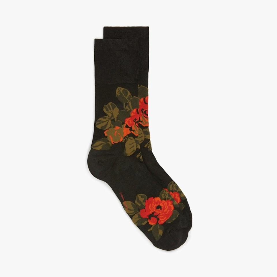 """As the temperatures continue to drop, consider a pair of floral socks by Simone Rocha to help you wear your sandals a little longer. $55, NORDSTROM. <a href=""""https://www.nordstrom.com/s/simone-rocha-rose-jacquard-ankle-socks/5641020?origin=category-personalizedsort&breadcrumb=Home%2FDesigner%2FSPACE%3A%20Emerging%20%26%20Advanced%20Designer%2FShop%20All&color=black%2F%20red"""" rel=""""nofollow noopener"""" target=""""_blank"""" data-ylk=""""slk:Get it now!"""" class=""""link rapid-noclick-resp"""">Get it now!</a>"""