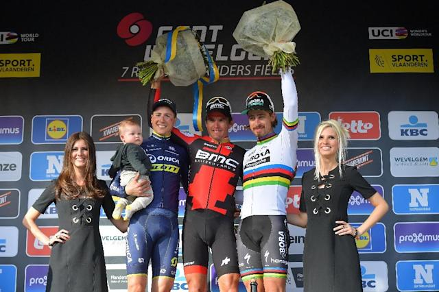 L-R: Belgian Jens Keukeleire of Orica Scott, Belgian Greg Van Avermaet of BMC Racing Team and Slovakian Peter Sagan of Bora-Hansgrohe celebrate on the podium on March 26, 2017 in Wevelgem after the Gent-Wevelgem one day cycling race (AFP Photo/DAVID STOCKMAN)