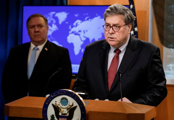 US Secretary of State Mike Pompeo (L) listens as US Attorney General William Barr speaks at a joint news conference on the International Criminal Court, at the State Department in Washington, DC, on June 11, 2020. (Yuri Gripas/AFP via Getty Images)