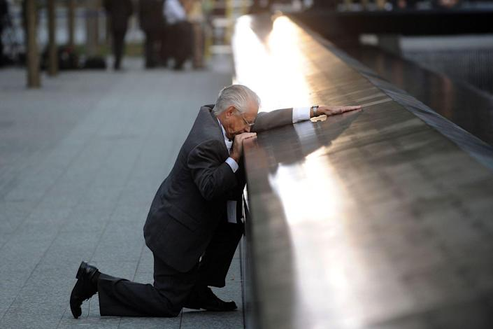"<p>Amidst a ceremony marking the 10th anniversary of the World Trade Center attacks, Robert Peraza, who lost his son Robert David Peraza on September 11, pauses at his late son's name at the North Pool of the 9/11 Memorial. </p><p><strong>RELATED: <a href=""https://www.redbookmag.com/life/a45910/hillary-oneill-born-911-story/"" rel=""nofollow noopener"" target=""_blank"" data-ylk=""slk:I'm About to Turn 15 Years Old. I Was Born on 9/11."" class=""link rapid-noclick-resp"">I'm About to Turn 15 Years Old. I Was Born on 9/11.</a></strong></p>"