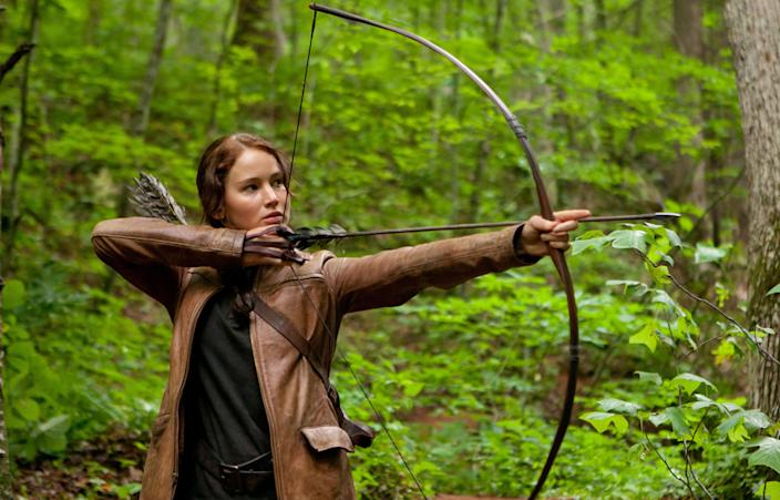 """""""The Hunger Games,"""" a film version of the 2008 young adult novel by Suzanne Collins starring Jennifer Lawrence, became an obsession for plenty of American moviegoers in 2012, grossing more than $400 million at the U.S. box office. (Murray Close/Lionsgate)"""