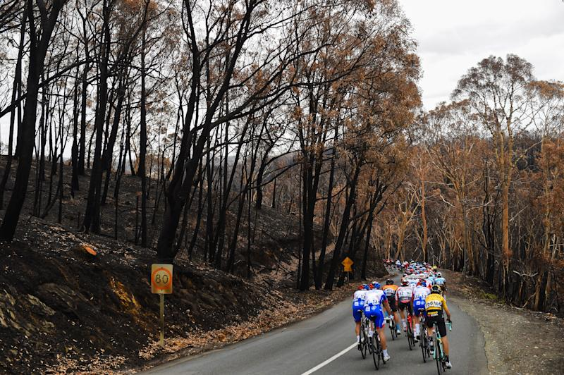 Riders pass through an area badly affected by the bushfires on stage 3 of the 2020 Tour Down Under between Unley and Paracombe