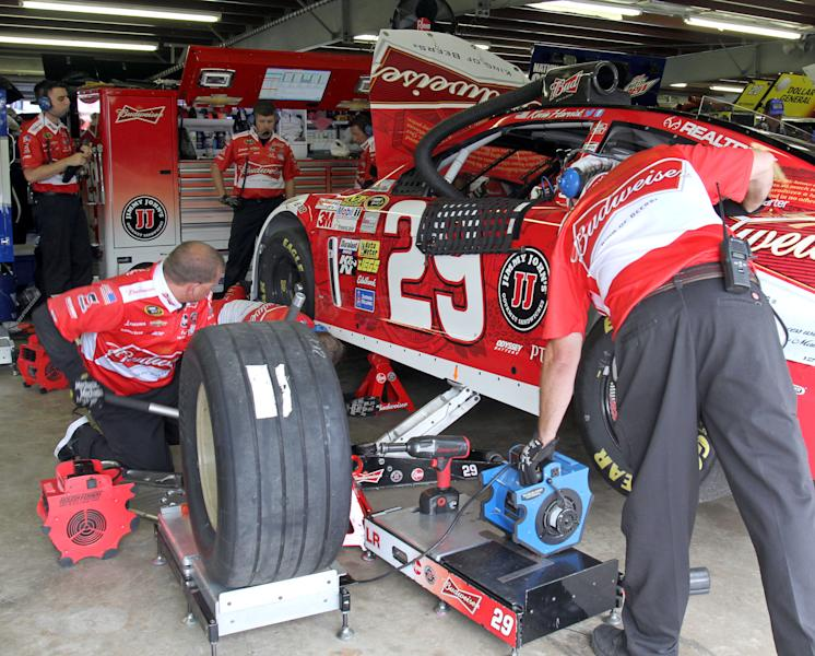 The crew for NASCAR driver Kevin Harvick work on his car during practice for the NASCAR New Hampshire Sprint Cup Series Camping World RV Sales 301 auto race, Friday, July 12, 2013 in Loudon, N.H. (AP Photo/Mary Schwalm)