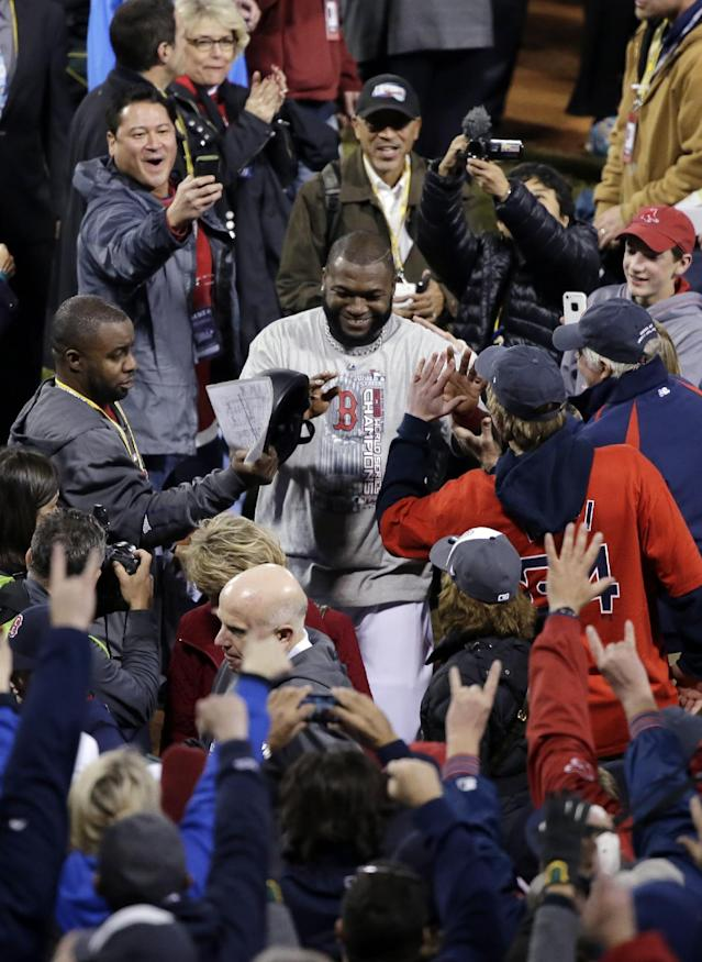 Boston Red Sox's David Ortiz celebrates after Game 6 of baseball's World Series against the St. Louis Cardinals Wednesday, Oct. 30, 2013, in Boston. The Red Sox won 6-1 to win the series. (AP Photo/Chris Carlson)