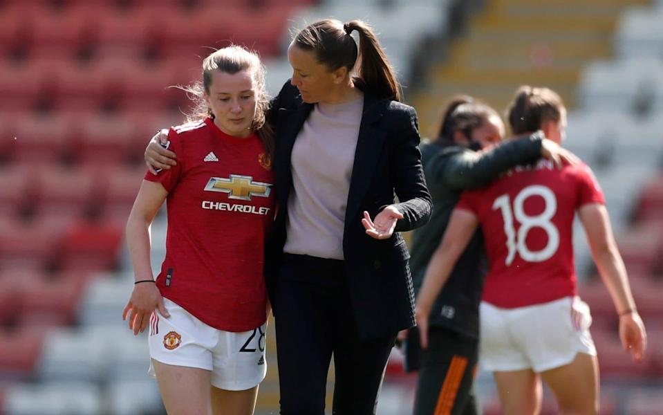 Manchester United manager Casey Stoney with Carrie Jones. - REUTERS