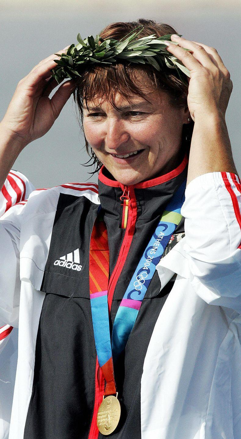 """<p>Already known as one of the top Olympic athletes in kayaking, Birgit Fischer decided that six Olympic medals wasn't enough. In 2004, she came out of retirement and joined the German team. Her seventh and eighth Olympic medals <a href=""""https://olympics.com/en/athletes/birgit-fischer"""" rel=""""nofollow noopener"""" target=""""_blank"""" data-ylk=""""slk:made history"""" class=""""link rapid-noclick-resp"""">made history</a>, as she became the first woman to win an Olympic medal 2o years after her first one. </p>"""