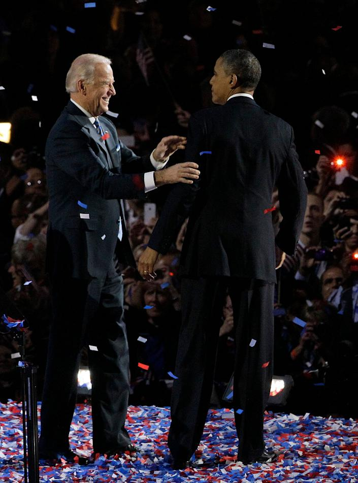 President Barack Obama talks to Vice President Joe Biden at his election night party Wednesday, Nov. 7, 2012, in Chicago. President Obama defeated Republican challenger former Massachusetts Gov. Mitt Romney. (AP Photo/Nam Y. Huh)