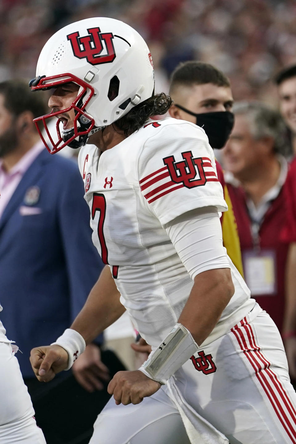Utah quarterback Cameron Rising celebrates after throwing a touchdown pass to wide receiver Money Parks during the first half of an NCAA college football game against Southern California Saturday, Oct. 9, 2021, in Los Angeles. (AP Photo/Marcio Jose Sanchez)