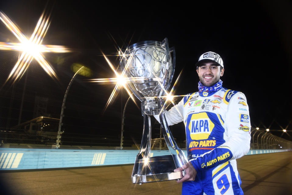 AVONDALE, ARIZONA - NOVEMBER 08:  (EDITOR'S NOTE: This image was created using a starburst filter) Chase Elliott, driver of the #9 NAPA Auto Parts Chevrolet, poses for a photo after winning the NASCAR Cup Series Season Finale 500 and the 2020 NASCAR Cup Series Championship at Phoenix Raceway on November 08, 2020 in Avondale, Arizona. (Photo by Jared C. Tilton/Getty Images)