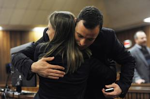 Oscar Pistorius hugs a supporter in the Pretoria High Court. (Getty Images)