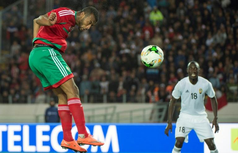 Ayoub el Kaabi (L) scores one of his nine goals that helped power hosts Morocco to the 2018 African Nations Championship title
