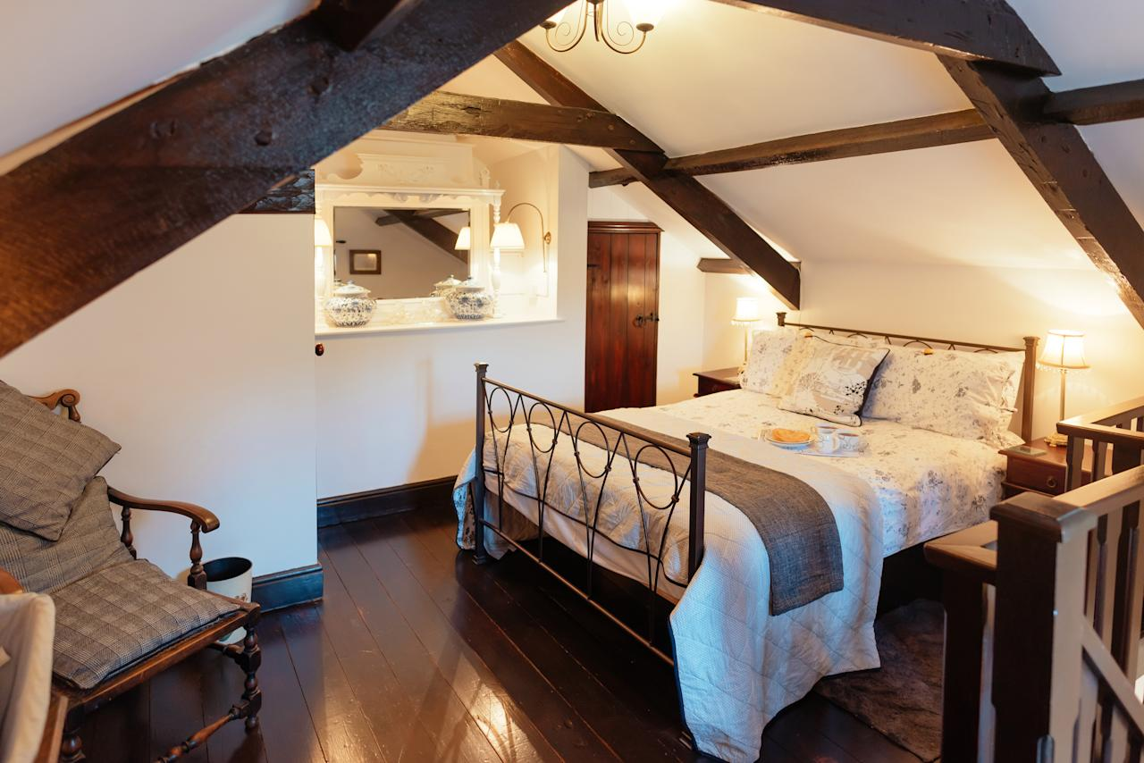 "<p>Low beams, stone walls and an original baker's fireplace and baker's oven make this <a rel=""nofollow"" href=""http://www.qualitycottages.co.uk/wales/south-wales/glamorganshire/gower-peninsula/gower/bakers-cottage"">one-bedroom bolthole</a> a great choice for couples looking to snuggle up when 2018 arrives. The cottage has a shared hot tub, and is an ideal base from which a couple can explore the Gower Peninsula with its beautiful beaches and dramatic cliffs. Seven nights from December 29 from £579. <em>[Photo: Quality Cottages]</em> </p>"