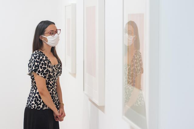 A woman wears a mask in a gallery in London. (Getty Images)