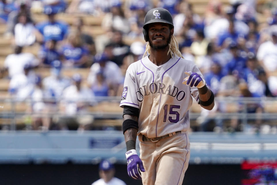 Colorado Rockies' Raimel Tapia gestures after stealing second during the fifth inning of a baseball game against the Los Angeles Dodgers Sunday, July 25, 2021, in Los Angeles. (AP Photo/Mark J. Terrill)