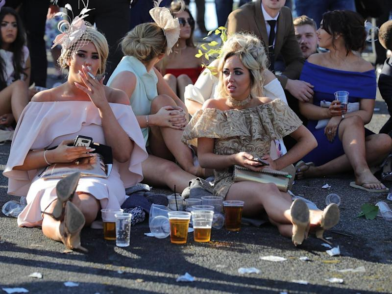 Punters at the end of another busy day at Aintree (Getty)