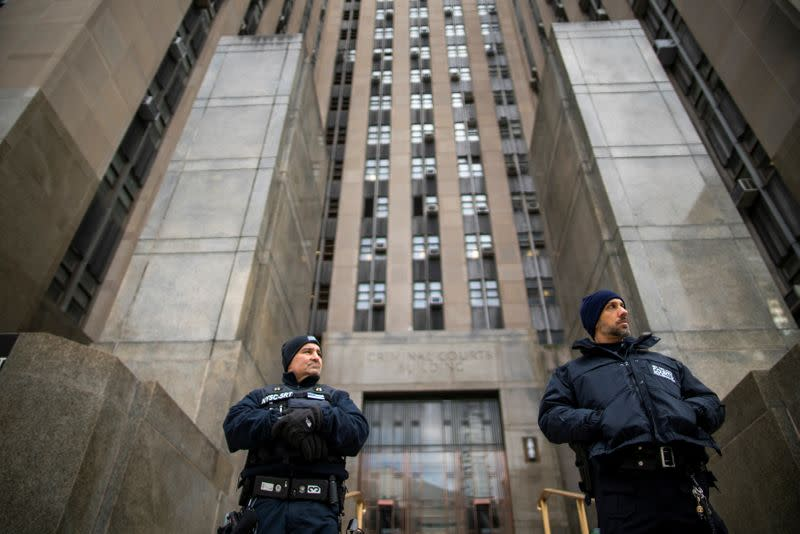 NYPD officers stand guard in front of New York Criminal Court while film producer Harvey Weinstein is having his sexual assault trial in the Manhattan borough of New York City