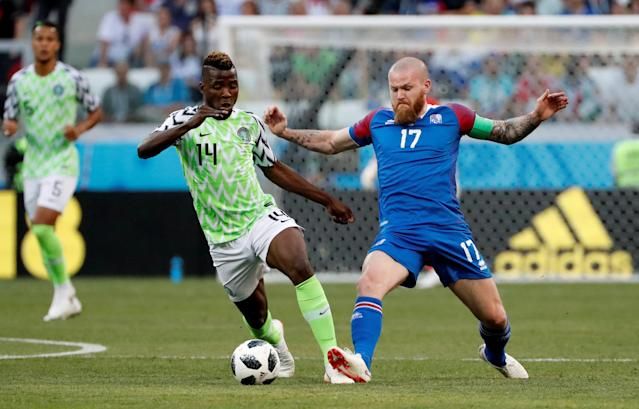 Soccer Football - World Cup - Group D - Nigeria vs Iceland - Volgograd Arena, Volgograd, Russia - June 22, 2018 Nigeria's Kelechi Iheanacho in action with Iceland's Aron Gunnarsson REUTERS/Jorge Silva