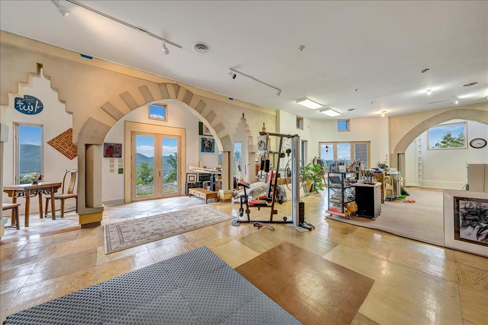 <p>Fit a workout in on the lower level of the home, or transform this into a library or media room.</p>