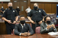 Actor Cuba Gooding Jr., center, sits at the defense table with his lawyer Marc Heller, during a hearing in his sexual misconduct case, Thursday, Aug. 13, 2020, in New York. A judge ordered the courtroom outfitted with Plexiglas and other measures to prevent the spread of the coronavirus, which has delayed the trial indefinitely. (Steven Hirsch/New York Post via AP, Pool)