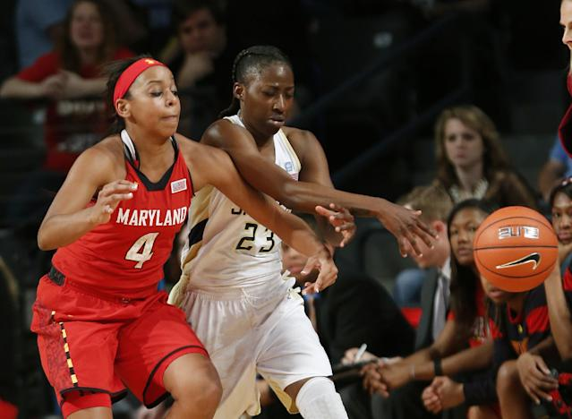 Maryland guard Lexie Brown (4) knocks the ball away from Georgia Tech guard Sydney Wallace (23) in the second half of an NCAA college basketball game, Sunday, Feb. 23, 2014, in Atlanta. (AP Photo/John Bazemore)