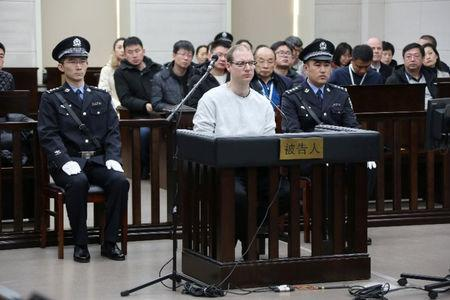 Canadian Robert Lloyd Schellenberg appears in court for a retrial of his drug smuggling case in Dalian, Liaoning province, China, January 14, 2019, in this handout picture received by Reuters January 15, 2019. Intermediate People's Court of Dalian/Handout via REUTERS