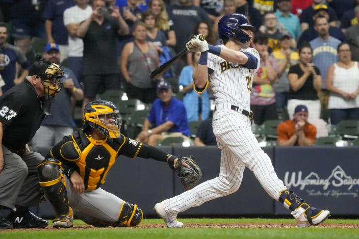 Milwaukee Brewers' Christian Yelich hits a two-run scoring double during the seventh inning of a baseball game against the Pittsburgh Pirates Friday, June 11, 2021, in Milwaukee. (AP Photo/Morry Gash)
