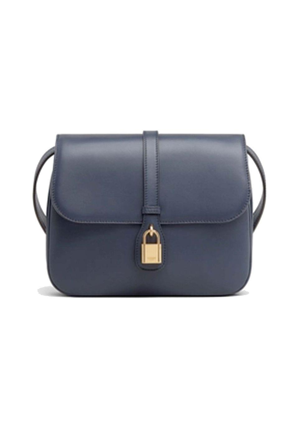 """<p><a class=""""link rapid-noclick-resp"""" href=""""https://www.celine.com/en-gb/celine-shop-women/handbags/more-lines/medium-tabou-in-smooth-calfskin-196583DK1.07OC.html"""" rel=""""nofollow noopener"""" target=""""_blank"""" data-ylk=""""slk:SHOP NOW"""">SHOP NOW</a></p><p>Celine is a firm favourite for chic accessories, crafted from the most luxurious materials. This Tabou saddle bag is particularly special – a signature style directly inspired by the Celine archives, which is available in number of classic colours, including navy and tan. </p><p>Textile and calfskin cross-body bag, £1,750, <a href=""""https://www.celine.com/en-gb/celine-shop-women/handbags/more-lines/medium-tabou-in-smooth-calfskin-196583DK1.07OC.html"""" rel=""""nofollow noopener"""" target=""""_blank"""" data-ylk=""""slk:Celine by Hedi Slimane"""" class=""""link rapid-noclick-resp"""">Celine by Hedi Slimane</a></p>"""