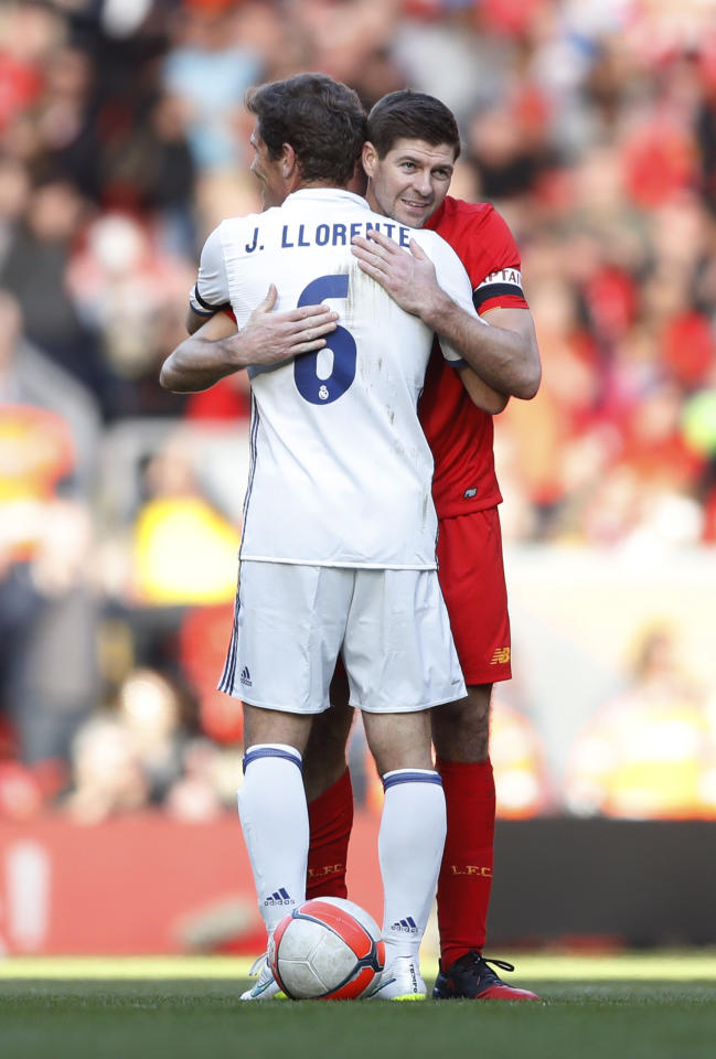 Britain Football Soccer - Liverpool Legends v Real Madrid Legends - Anfield - 25/3/17 Liverpool's Steven Gerrard hugs Real Madrid's Julio Llorente after the game Action Images via Reuters / Carl Recine Livepic EDITORIAL USE ONLY.