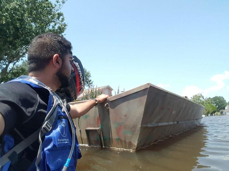 AMYA volunteers set out by boat to rescue Houston residents trapped in their homes.