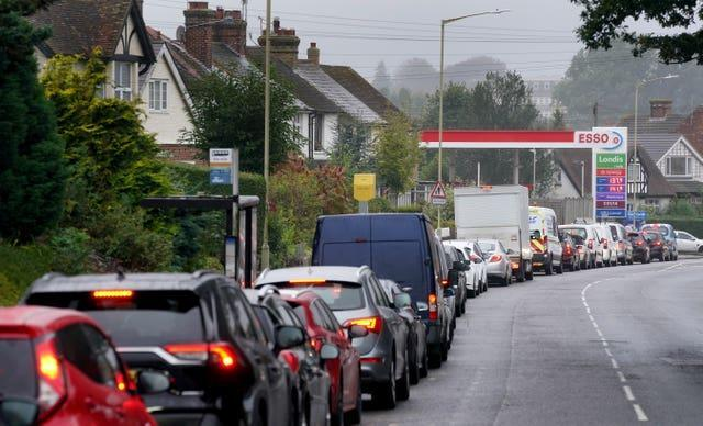 Motorists queue for fuel at an Esso petrol station in Ashford, Kent