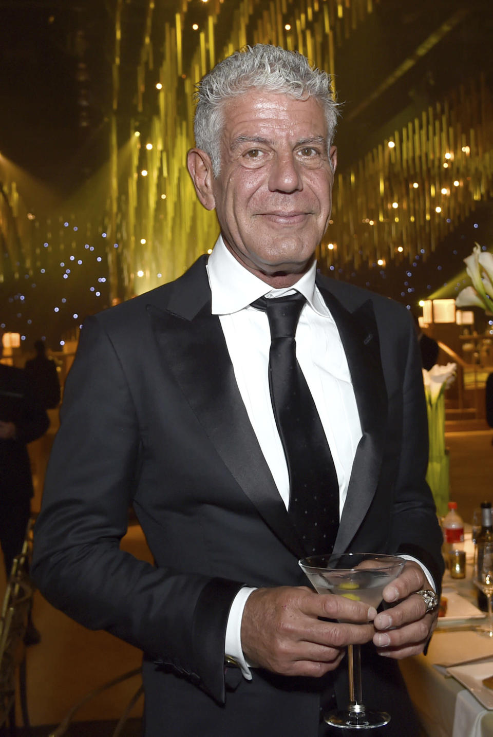 """FILE - In this Saturday, Sept. 9, 2017, file photo, Anthony Bourdain attends the Governors Ball during night one of the Creative Arts Emmy Awards at the Microsoft Theater in Los Angeles. The revelation that a documentary filmmaker used voice-cloning software to make the late chef Bourdain say words he never spoke has drawn criticism amid ethical concerns about use of the powerful technology. The movie """"Roadrunner: A Film About Anthony Bourdain"""" appeared in cinemas Friday, July 16, 2021, and mostly features real footage of the beloved celebrity chef and globe-trotting television host before he died in 2018. (Photo by Richard Shotwell/Invision/AP, File)"""