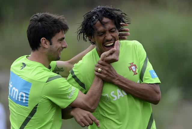 Portugal's forward Helder Postiga (L) jokes with defender Bruno Alves (R) on May 30, 2012 in Praia del Rey near Obidos, central Portugal, during a training camp in preparation for the Euro 2012 football championship, which will take place in Poland and Ukraine from June 8 to July 1. AFP PHOTO/ FRANCISCO LEONGFRANCISCO LEONG/AFP/GettyImages