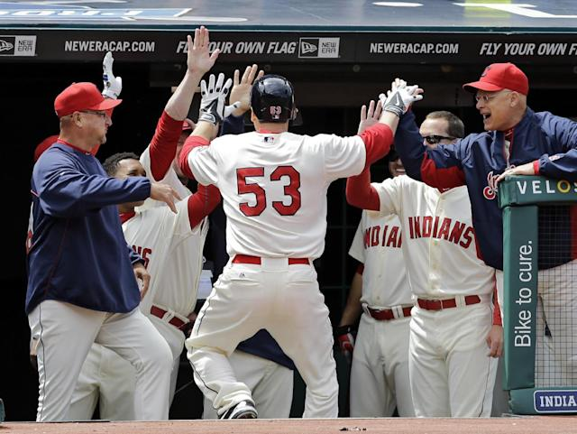 Cleveland Indians' George Kottaras (53) is greeted at the dugout after his solo home run off Chicago White Sox starting pitcher Andre Rienzo in the third inning of a baseball game on Sunday, May 4, 2014, in Cleveland. (AP Photo/Mark Duncan)