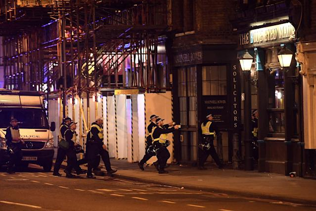 <p>Armed police raid The Blue Eyed Maid in Borough high street at London Bridge on June 3, 2017 in London, England. Police have responded to reports of a van hitting pedestrians on London Bridge in central London. (Carl Court/Getty Images) </p>