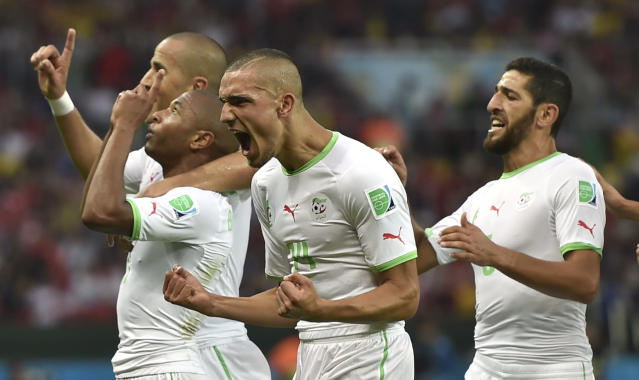 Algeria's Yacine Brahimi, front left, celebrates after scoring his side's fourth goal during the group H World Cup soccer match between South Korea and Algeria at the Estadio Beira-Rio in Porto Alegre, Brazil, Sunday, June 22, 2014. (AP Photo/Martin Meissner)