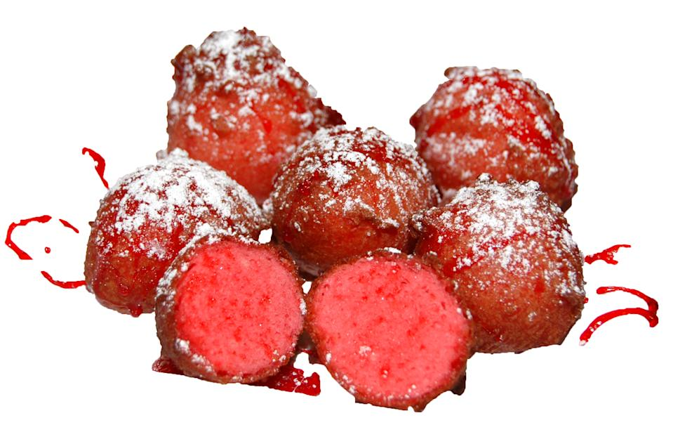 """<a href=""""http://www.chickencharlies.com/index.html"""" rel=""""nofollow noopener"""" target=""""_blank"""" data-ylk=""""slk:Deep-fried Kool Aid"""" class=""""link rapid-noclick-resp"""">Deep-fried Kool Aid</a> is made with flour, water and cherry flavored Kool-Aid."""