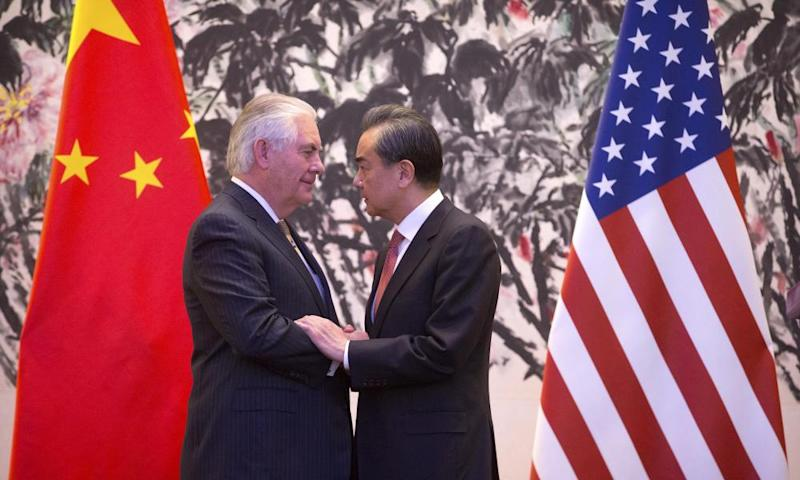 The US secretary of state, Rex Tillerson, and the Chinese foreign minister, Wang Yi, shake hands at the end of a joint press conference in Beijing.