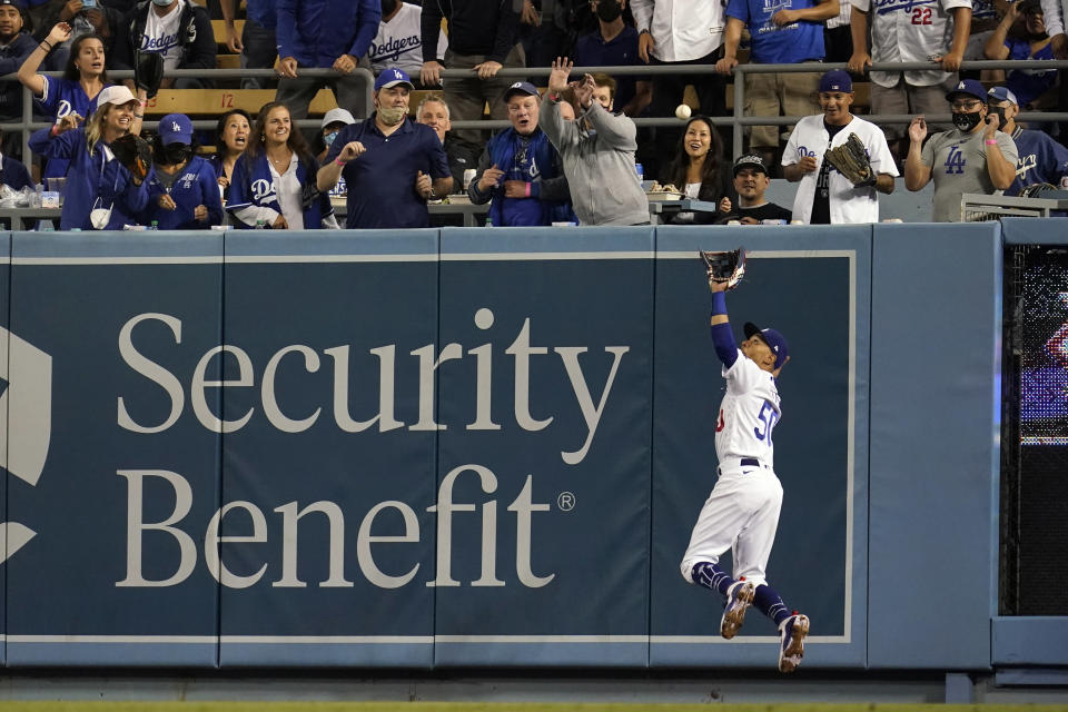 Los Angeles Dodgers right fielder Mookie Betts makes a leaping catch on a pop fly by Arizona Diamondbacks' Christian Walker during the sixth inning of a baseball game Monday, Sept. 13, 2021, in Los Angeles. (AP Photo/Marcio Jose Sanchez)