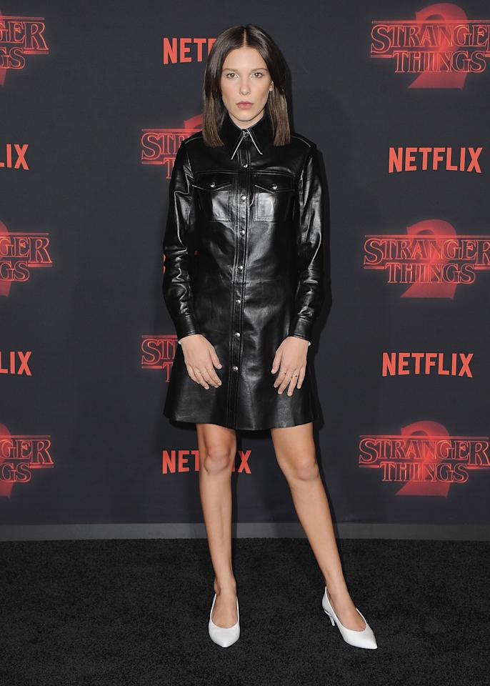 <p>The 13-year-old actress swapped her girly ballgowns for a tough leather shirtdress by Calvin Klein.<br /><i>[Photo: Getty]</i> </p>