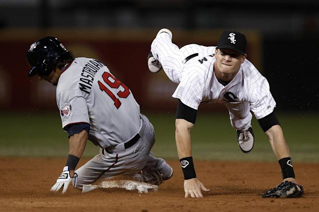 Chicago White Sox second baseman Gordon Beckham watches his throw to first after he forced out Minnesota Twins' Darin Mastroianni during the third inning of a baseball game on Tuesday, Sept. 17, 2013, in Chicago. Brian Dozier was safe at first. (AP Photo/Andrew A. Nelles)