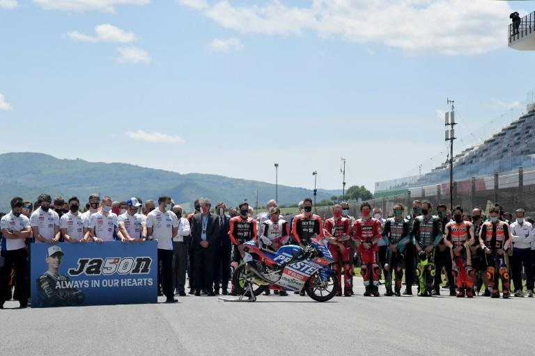 Riders observe a minute's silence