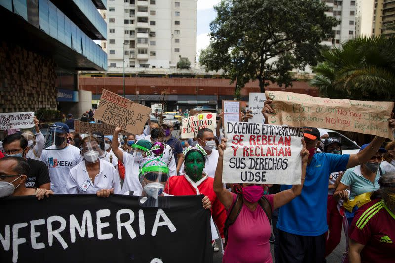 Guillen participates in a protest against low wages in Caracas