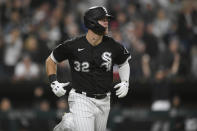 Chicago White Sox's Gavin Sheets watches his solo home run during the fourth inning of a baseball game against the Cincinnati Reds Tuesday, Sept. 28, 2021, in Chicago. (AP Photo/Paul Beaty)