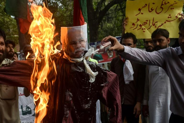 Protesters in Lahore, Pakistan, burn an effigy of Indian Prime Minister Narendra Modi during a protest after he revoked special autonomy for Indian-administered Kashmir (AFP Photo/ARIF ALI)
