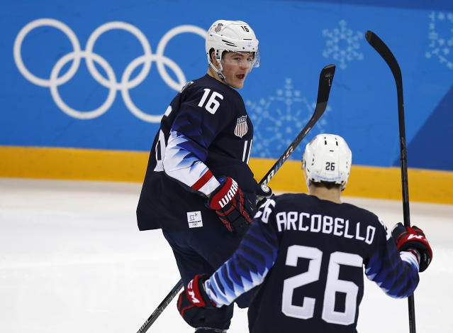 Ryan Donato (16), of the United States, celebrates with Mark Arcobello (26) after scoring a goal against Slovakia during the second period of the qualification round of the men's hockey game at the 2018 Winter Olympics in Gangneung, South Korea, Tuesday, Feb. 20, 2018. (AP)